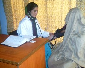 A4T midwife taking the blood pressure of a patient, May 2014